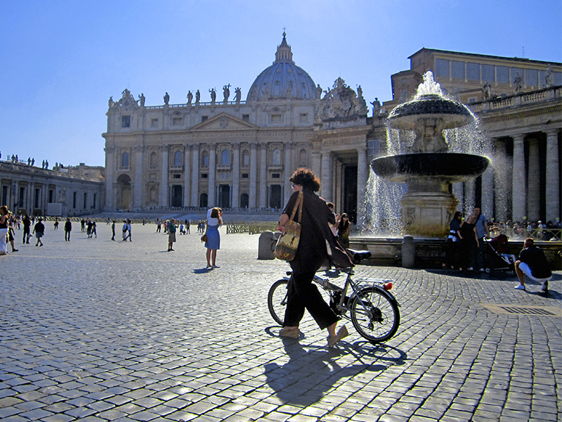 woman with a bicyle in Vatican City