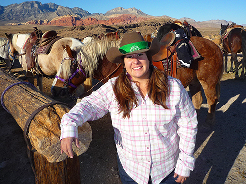 a cowgirl by her horse in Horseback riding Las Vegas