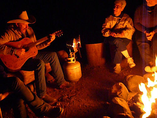 people around a camp fire on Cowboy Trail Rides