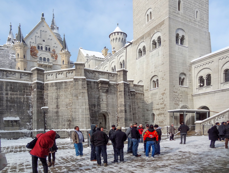 people at a castle in the snow