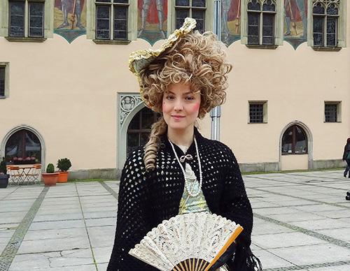A tour guide outside Passau's Rathaus in Passau