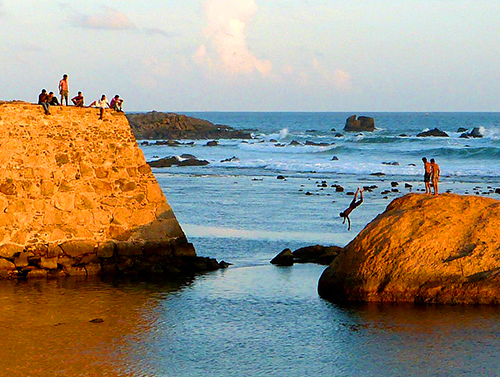 Kids diving outside of Galle fort