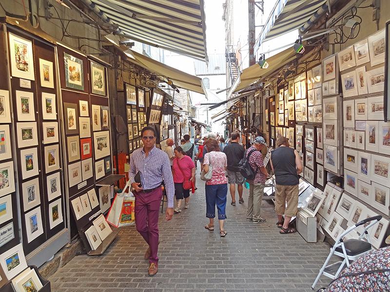 people walkinh through an outdoor art exhibit