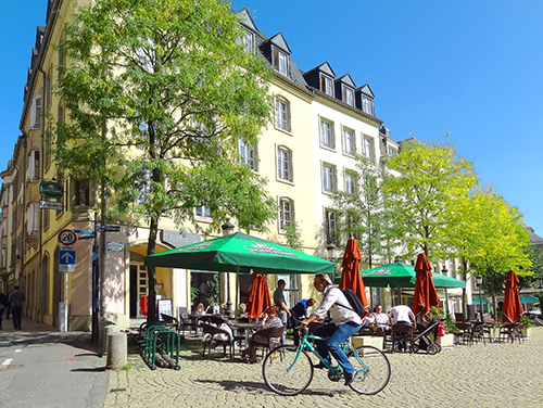 Enjoying coffee in a café near Place Guillaume II, one of the things to do in Luxembourg
