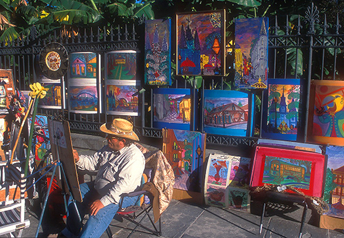 Seeing sidewalk artists in Jackson Square, one of the things to do in New Orleans on a budget. in New Orleans/ photo: NewOrleansOnline.com/Alex Demyan