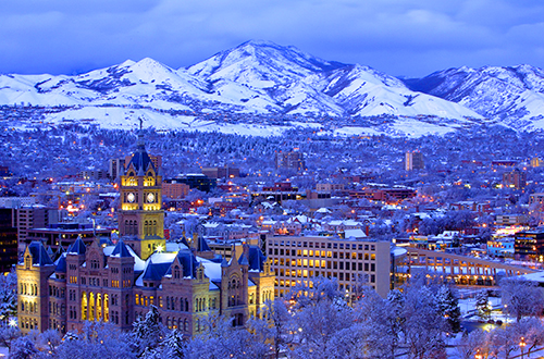 a view of a city in snow, where there are many things to do in salt lake city