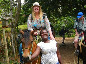woman on horse riding to El Limon Waterfalls