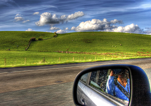 view of hills from a rental car in Europe