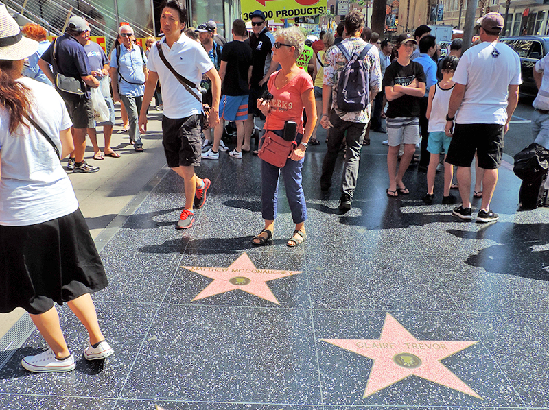 people walking on the Hollywood Walk of Fame, one of the popular things to do in LA