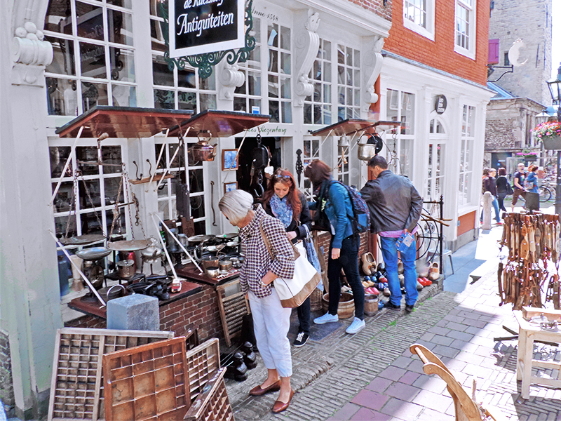 people at an antique shop seen on day trips from Amsterdam