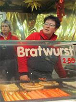 a woman selling bratwurst