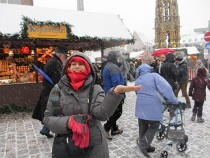 a woman in a winter market