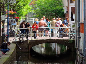 people on a bridge in Delft, seen on day trips from Amsterdam