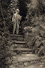Mark Twain on the steps to his study in New York