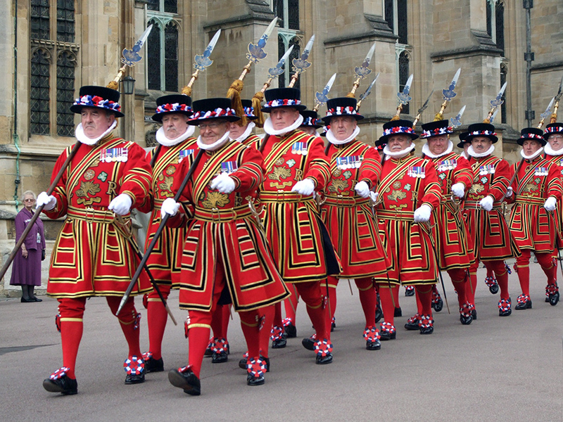 guards in red dress marching
