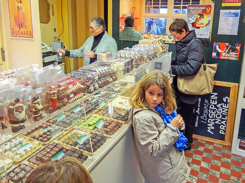 people in a shop buying Belgian chocolates