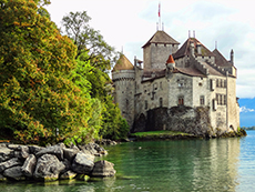 a castle on the shore of a lake