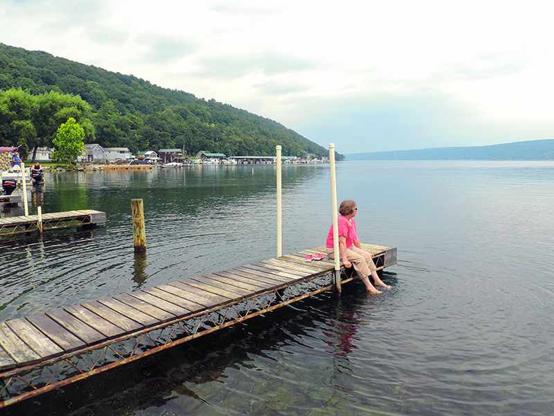 sitting on a dock - things to do in the Finger Lakes