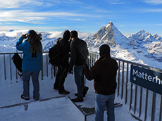 People looking across the Alps from Glacier Paradise in Switzerland among my memorable travel experiences