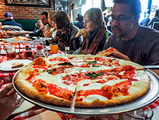 Pizza on a plate at restaurant among my memorable travel experiences