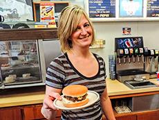 woman serving a hamburger at Hudson's Hamburgers, Coeur d'Alene among my memorable travel experiences