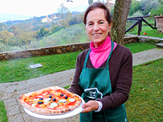 Woman holding pizza among my memorable travel experiences