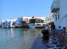 People having drinks on Little Venice on Mykonos among my memorable travel experiences