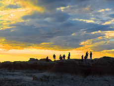People looking at sunrise in Badlands National Park among my memorable travel experiences