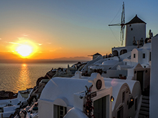 Sunset in Oia by a windmill among my memorable travel experiences