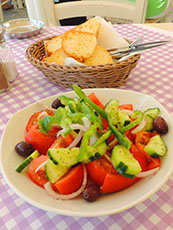 salad and bread on table at restaurant in Mykonos Town