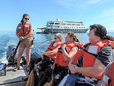 people with life jackets on in a boat inthe Sea of Cortez