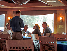 Passengers ordering dinner in a ship's dining room on a Sea of Cortez cruise
