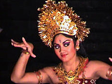 dancer with large headress moving her arms
