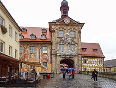 people walking past a building covered with colorful murals in one of the best German towns to visit