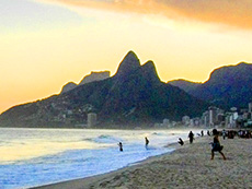 people going in to the ocean in Brazil, one of the countries requiring visas for US citizens
