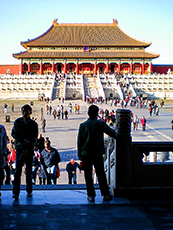 people walking about a large square in China's Forbidden City