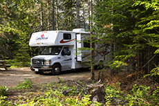 a camper parked in the woods in Québec