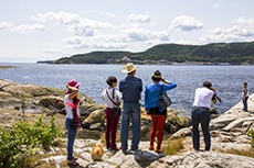 people standing on the shore of of the Saguenay Fjord