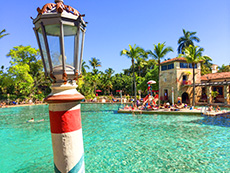 colorful lamppost by a large pool in Miami