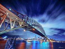 a bridge across a city harbor in Australia, one of the coutries requiring visas for US citizens