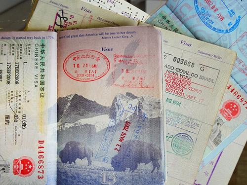 a passport with visa stamps from countries requiring visas for US citizens
