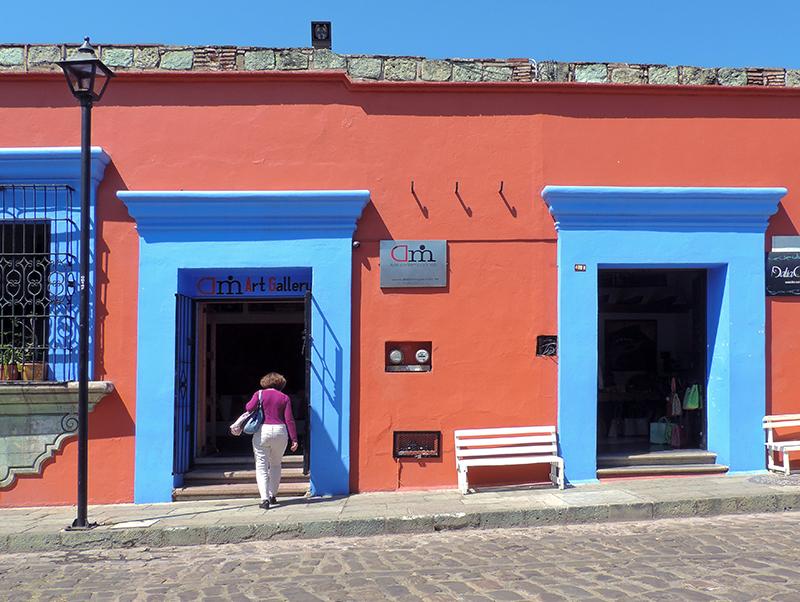 woman walking through a blue doorway