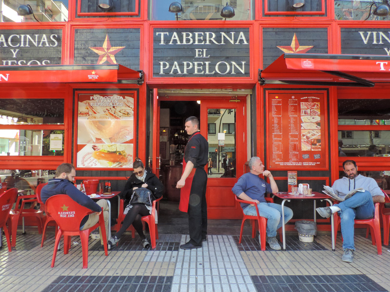 Relaxing outside a taberna, one of the things to do in Seville