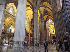 high vaults inside a large cathedral in Seville