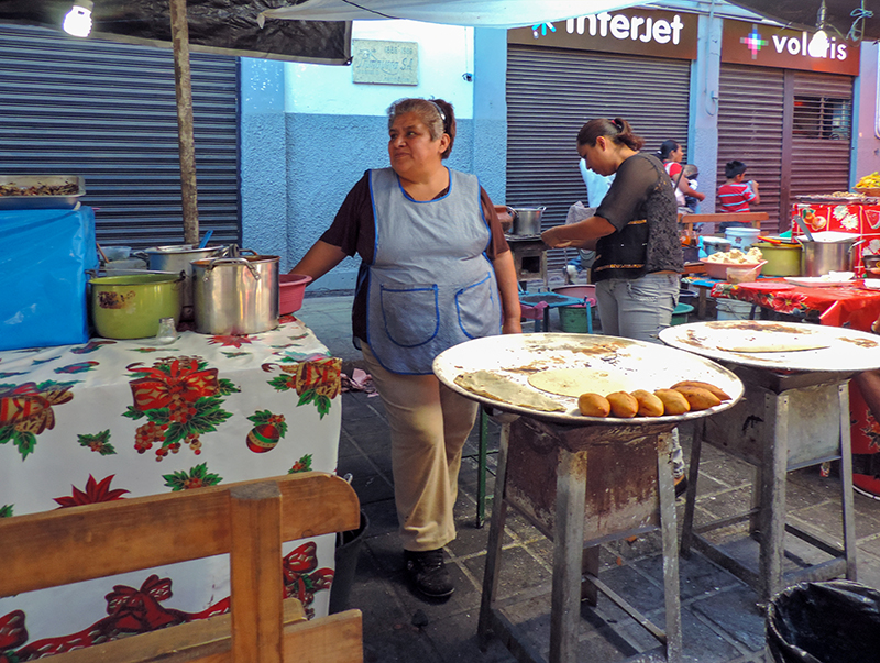 a group of food vendors - things to do in Oaxaca