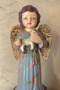 statue of an angel holding a lamb