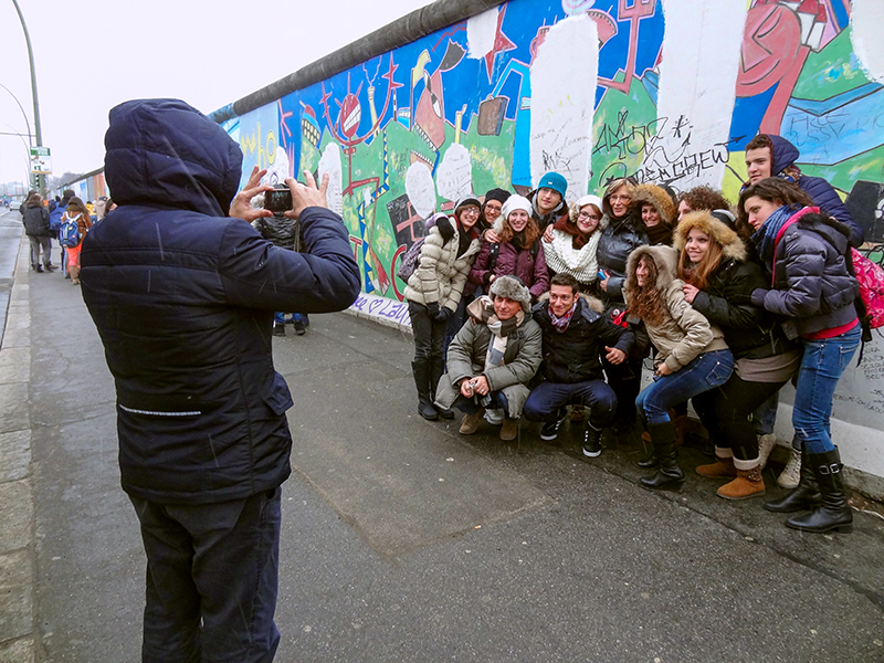 a group being photographed in front of the Berlin Wall, one of the things to see in Berlin