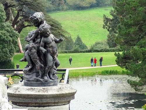 a statue by a pond