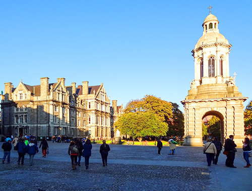 people walking through Trinity College, one of the places to visit in Dublin