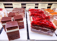 strawberry and chocolate pastries in a display -- one of the best things to do in Salzburg